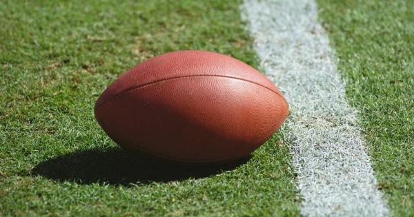 Close of football on yard line stripe. American Football