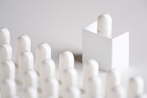 Pill Conference. A pill on a podium addresses lines of pills