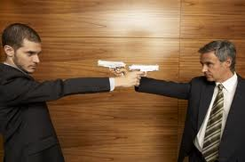 workplace violence businessmen pointing guns